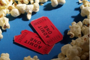 popcorn and tickets on a blue tablecloth
