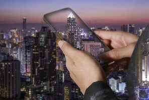 woman holding a smart phone and city night scene