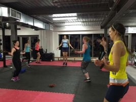 women skipping with ropes in a gym