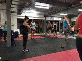 women in a gym skipping with ropes