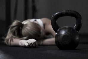 drained woman after hard crossfit training