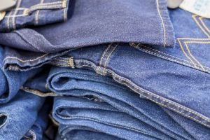 Lot of blue jeans, jeans stacked