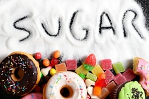 the word sugar, written in sugar and surrounded by sweets