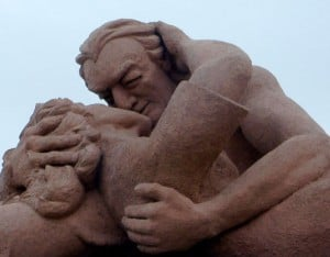 statue of man and women embracing