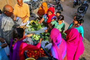 Women buying fresh fruit In India
