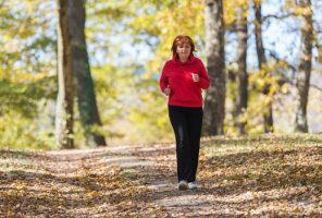 older woman gently running in park