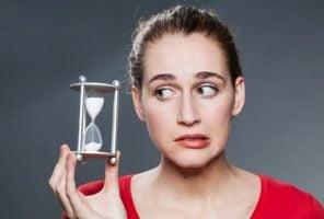 woman looking at egg timer