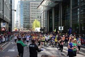 London, UK- April 13, 2014: London Marathon in Canary Wharf aria, massive sport event for professionals and amateurs sportsmen, Champions League