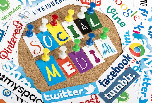 Belgrade, Serbia - June 12, 2014: Social media words made from letters pinned to a cork bulletin board and social media website logos printed on paper