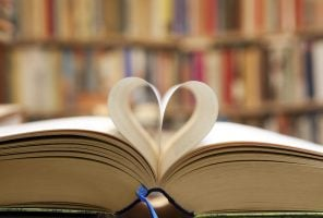 Free book club: Book page in heart shape with library background