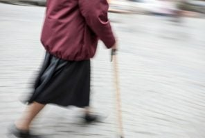 elderly lady walking with stick