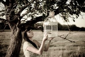 Lady holding birdcage
