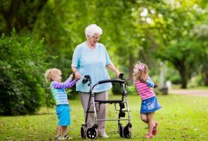 elderly lady with 2 grandchildren