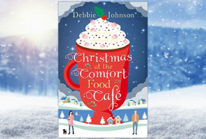 Front cover of Christmas at the Comfort Food Cafe against a blue Christmas scenic image