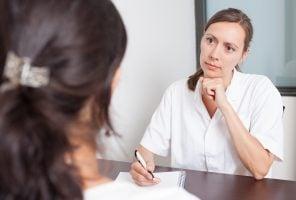 Menopause women talking to female doctor