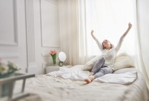 Woman stretching after good night's sleep