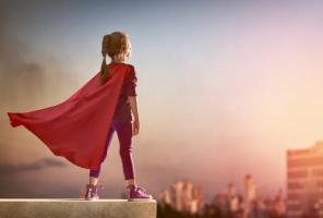girl dressed as super hero