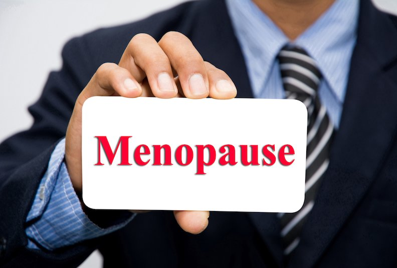 Businessman holding menopause card