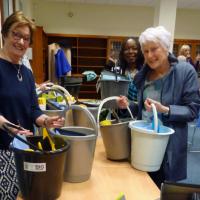 Women packing help packs for Women's Refuge