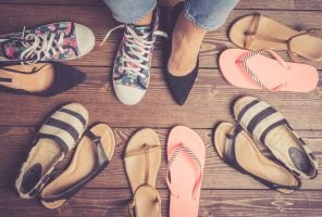 Collection of female shoes on wooden floor.