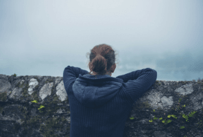woman looking into mist alone