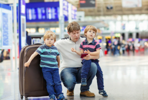 father and 2 small boys at airport