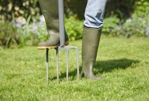 Person gardening with a garden fork