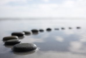 Divorce: stones on tranquil water to represent easiness