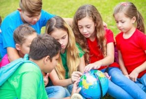 Children with a globe are learning about the world