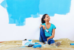 Woman looking at a wall she's painted