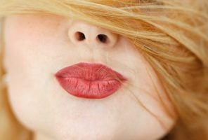 Woman pouting lips