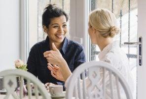 Friendship: two friends having coffee