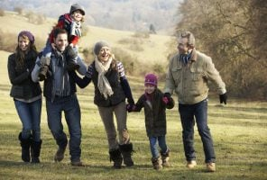 Menopausal woman and 3 Generation family on having fun on country walk in winter