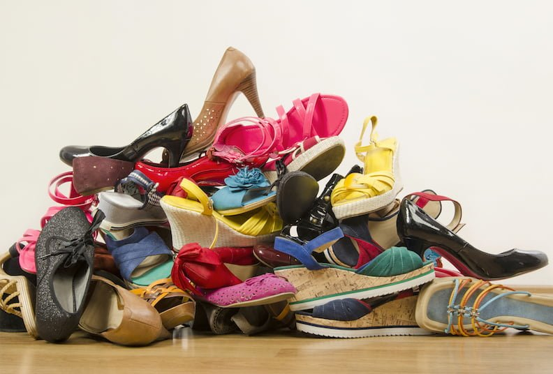 Declutter: Untidy stack of shoes thrown on the ground.