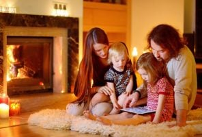 Gas systems: family in front of a gas fire