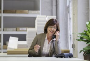 Entrepreneurs: midlife woman on the phone in an office