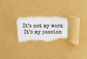 Text It's not my work It's my passion appearing behind ripped brown paper.