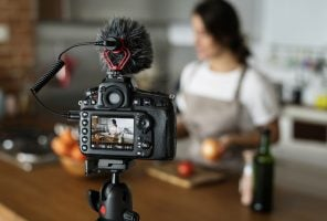 digital marketing trends: female vlogger recording a post
