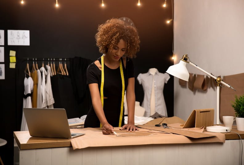 Female entrepreneur: woman in a fashion design studio