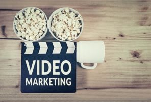 promotional video marketing: camera made up of clapper board and popcorn