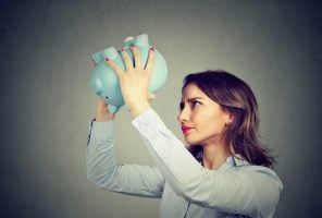 Investment scam worried woman with empty piggy bank