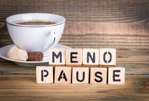 menopause. Wooden letters on the office desk