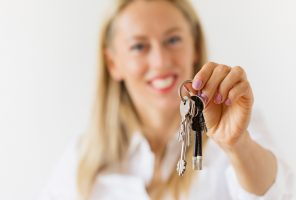 Woman holding new house or apartment keys